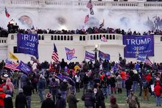 In this Jan. 6, 2021 file photo rioters supporting President Donald Trump storm the Capitol in Washington. (AP Photo/John Minchillo) Act Of Treason, Us Capitol, Capitol Hill, Law Enforcement Agencies, Thing 1, Capitol Building, Investigations, Washington, Donald Trump