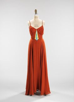 """The Moonstone"" Designer: Elizabeth Hawes (American, Ridgewood, New Jersey 1903–1971 New York) Date: spring/summer 1938 Culture: American Medium: silk Dimensions: Length at CB (a): 58 in. (147.3 cm) Length at CB (b): 15 in. (38.1 cm)"