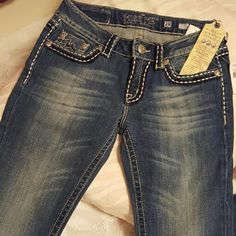 """Miss Me """"Sunny"""" jeans Skinny, cotton/spandex, white & blue plushy stich embroidery, silver color metal accents. Miss Me Jeans Skinny"""