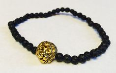 This is a very cool bracelet that is handmade in the USA.  The Tibetan style lion head is a metallic gold antique color made of alloy. The beads are natural lava gemstones (black). This bracelet will stretch to fit. May this bracelet bring you peace and healing within as well as strength and courage. A portion of each bracelet sold will go to the St. Jude Childrens Research Hospital. This bracelet is made by jj stevens, a family owned and operated fashion line. Made in the USA. We have a…