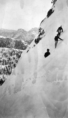 Photo of three men ascending the East Lion on the North Shore circa 1920. Photo by Franklin Walter Hewton courtesy the Vancouver Archives.