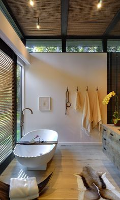 Robins Way House by Bates Masi Architects -- gorgeous clerestory windows, simple materials and stark white freestanding bathtub make this a contemporary work of art -- lots of hooks for towels and robes trump towel bars