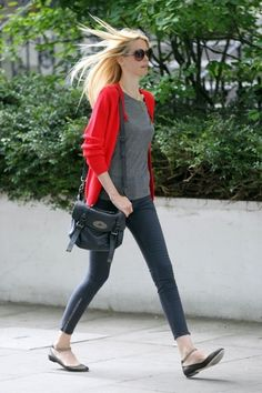 Claudia Schiffer Casual Neutral Look with a Bright Red Cardigan