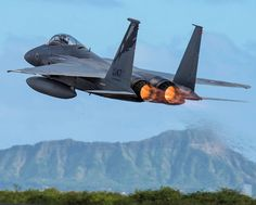 U.S. Air Force F-15 Eagle from California Air National Guard's 144th Fighter Wing takes flight over Diamond Head during Sentry Aloha 18-01 at Joint Base Pearl Harbor-Hickam, Hawaii.