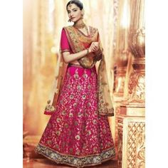 Sonam Hot Pink and Golden Beige Heavy Embroidered Lehenga