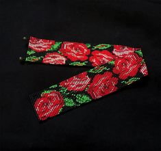 Loom beaded wide choker with red roses and green sleeves on a black background. This pattern carries a Ukrainian folk character, cheerful summer accessory. Chocker made out of red, green and black seed beads with two bigger beads as a clasp. Length: 35 cm or 13.8 inches Width: 4 cm or