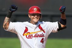 St. Louis Cardinals' Yadier Molina reacts after driving in a run with a single in seventh inning action during a game between the St. Louis ...