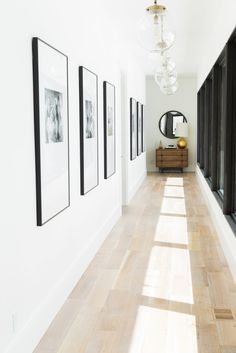 Modern interpretation of a family photo gallery wall, Love it! And those lights and the quantity used...they complement rather than overwhelm. Great design by Studio McGee