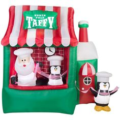 Santa's Taffy Stand Christmas Inflatable. Santa and his penguin helpers have opened a new taffy shop for Christmas 2017.  This cool looking new 2017 Christmas inflatable will be a main attraction with the kids in the neighborhood.  And to boot this Santa inflatable is animates in motion.