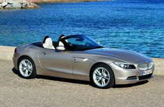 BMW silver sports cars stands at river. What a fantastic look! Go for long drive with gf in this car.