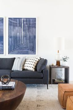 8Mid-century+great+room+with+modern+sectional,+round+coffee+table,+and+modern+artwork..jpg