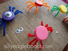 Bottle cap spiders...i made these several years ago with 2 liter bottle caps. I cut the pipe cleaners in half and hot-glued them, individually, to the inside edge of the cap. I put the small jiggle eyes on the outside edge rather than top. The hang well on the packaged spider 'webs' as well.