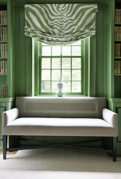Green and white relaxed roman shade.