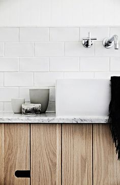 Renovated bathroom Elwood House.  Bespoke tile and stone concrete tiles, Enoki Light, oak, carrara joinery, spa featured in Vogue LIving bathroom issue