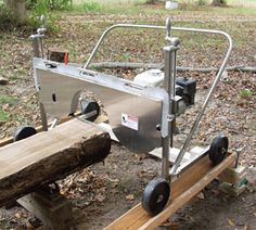 Sawmill, in driveway, complete with cover