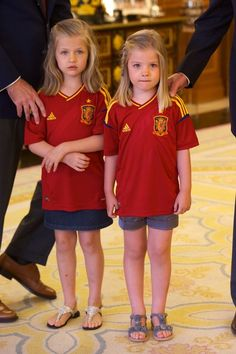 Princess Leonor of Spain and Princess Sofia of Spain stand as King Juan Carlos I of Spain receives the players of Spain's victorious national football team at Zarzuela Palace on July 2, 2012 in Madrid, Spain.