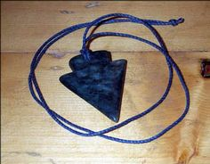 Carving an arrowhead pendant with soapstone