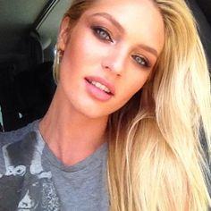 Candice Swanepoel...I think if you look like this you are allowed to take selfies...the problem being people think they do look like this...eek
