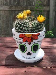 painted flower skull hand pot Skull Hand Painted Flower PotYou can find Painted flower pots and more on our website Clay Flower Pots, Flower Pot Crafts, Clay Pot Crafts, Clay Pots, Painted Plant Pots, Painted Flower Pots, Decorated Flower Pots, Flower Pot People, Flower Pot Design
