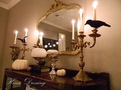Elegant spooky Halloween sideboard with crows and white pumpkins