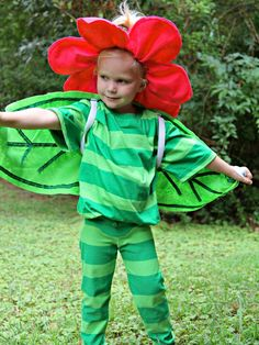 Easy DIY Halloween Costume: Flower With Big Petals : Home Improvement : DIY Network easy movement with the leaf as a cape, this could be made into different types of flowers, similar to Maud Lewis' paintings. Easy Homemade Halloween Costumes, Halloween Costumes Pictures, Dinosaur Halloween Costume, Easy Diy Costumes, Halloween Kids, Costume Ideas, Halloween Crafts, Last Minute Halloween Kostüm, Flower Costume