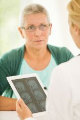 Senior patient and doctor discussing MRI-Scan stock photo