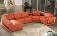 This modern sofa is upholstered in orange bonded leather which is accented by small, triangular, black tabletop surfaces by the corner of the sofa. On the ends of the sectional are two shelving areas.  Buy it here! http://moderncontempo.com/2315-modern-orange-bonded-leather-sectional-sofa.html