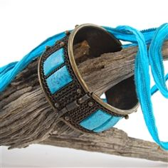 This modern cuff bracelet has a vintage vibe to it thanks to antiqued brass. The turquoise colored rectangular beads accent the dark toned brass perfectly. We love the fact that it is hinged for ease of use. #fashionjewelry