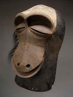"""Luba Monkey Mask Ethnic Group: Luba peoples Country: Dem. Rep. of Congo Materials: Wood, pigments, fur tufts Height: 15"""" x 8"""". (38 cm. x 20 cm.) Approximate Age: 20th Century"""