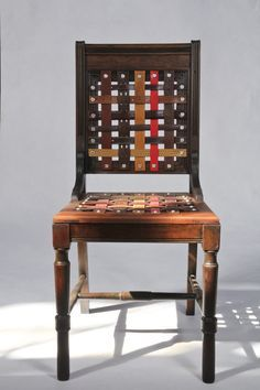 Wouldn't a thrifted rattan seat chair look perfect in a tack room with a seat woven from old reins, stirrup leathers, or leads?