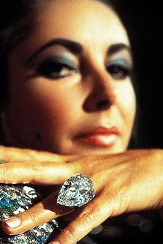 Elizabeth in 1972... Showing Off the FIRST 'Publicly' Auctioned  and Sold.. {sold to Richard Burton who gifted it to his wife, Elizabeth Taylor -  in 1969}... $$1Million$$-Dollar-$Plus...68+ Carat, - Burton/Taylor Diamond Ring. -by Norman Parkinson by Andrew Garth, via Flickr.