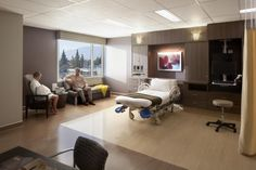 Private rooms in the labor and delivery department are designed with a residential feel. The medical headwall is integrated into what appears to be built-in residential furniture. Photo: Lawrence Anderson