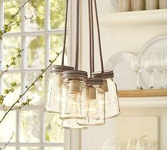 pottery barn 5 jar chandelier glass canning jars suspended from a galvanized canopy on gray fabric cords of different lengths. Mason Jar Light Fixture, Mason Jar Chandelier, Mason Jar Lighting, Mason Jar Lamp, Light Fixtures, Kitchen Lighting, Light Bulb, Light Fittings, Pantry Lighting