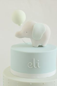 this adorable christening cake was based on my bastian bird cake and the super cute baby elephant invitation design by style me gorgeous! i also made these favour cookies to match- even afte Idee Baby Shower, Baby Shower Cakes, Hello Naomi, Baby Elephant Cake, Baby Birthday Cakes, Cake Baby, Baby Boy Baptism, Christening Cake Boy Simple, Christening Cakes
