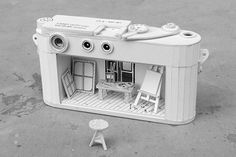 Ordinary Behavior In his new series Ordinary Behavior, artist Kevin LCK builds dioramas into everyday electronic objects made from cardboard, like this camera.  Via The English Group.