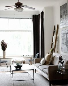 use a ladder in the living room for blanket hanging.