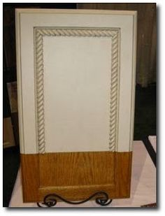 Adding rope molding to cupboards for custom look. very inexpensive and easy fix