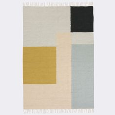 MODERNIST GEOMETRIC RUG IN PASTEL SHADES BY DANISH INTERIORS BRAND, FERM LIVING.  PERFECT FOR OPEN SPACES, THIS BOLD TEXTILE PIECE ADDS WARMTH AND A HINT OF 70'S INSPIRED DECOR TO ANY ROOM. THE RUG WORK WELL USED TRADITIONALLY AS A FLOOR MAT OR DISPLAYED IN AMORE USUAL WAY AS WALL ART AS SEEN IN THE LIFESTYLE IMAGE.