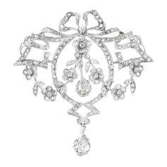 Belle Epoque Platinum and Diamond Garland Pendant-Brooch   2 pear-shaped diamonds ap. .50 ct., small old-mine & rose-cut diamonds, c. 1905, ap. 10 dwt.