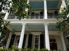 Antebellum Greek Revival house on St. Charles Ave in New Orleans