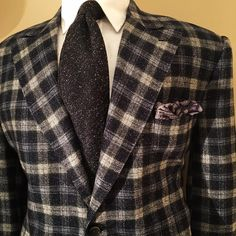 Silk and wool tweed jacket, wool crepe mouchoir de poche and pure silk tweed tie. Silk, one of the oldest fibers known to man, originated in China. According to well-established legend, Empress Hsi Ling Shi, wife of Emperor Huang Ti (also called the Yellow Emperor), was the first person to discover silk as a wearable fiber, all be it by accident. It is said that one day while the empress was sipping tea under a mulberry tree, a cocoon fell into her cup and began to unravel. She became so…