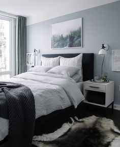 Bedroom Makeover: The Reveal - Bright Bazaar by Will Taylor see how reindeer rugs pair with grey walls ands stylish white ash bedside table!