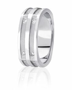 Diamonds Are Flush Set Into Carved Channels And Then Sand Blasted In This Modern Wedding Band With Raised Polished Center and Edges