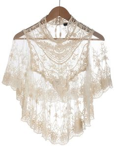 lace is one of the prettiest imitations ever made of the fantasy of nature    Photographic Flashback Cape in Ivory, #ModCloth #Mckernan