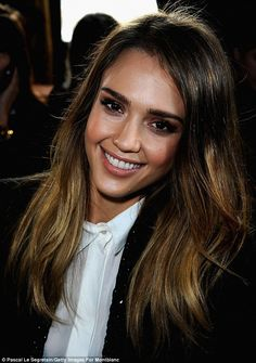 Raising eyebrows: Jessica Alba sports thick and dark eyebrows as she sits in the front of Stella McCartney's Paris Fashion Week show on Monday morning