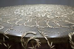 A Tablecloth Created with Lace-like Patterns of Collected Seeds by Rena Detrixhe