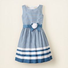 striped dress $26.21 reg - $34.95    Made of printed cotton poplin  Fully lined in cotton voile  Pull-on style with hidden back zipper closure  Grosgrain ribbon at the waist, embellished with mesh and georgette flower  Designed in an at-the-knee length.