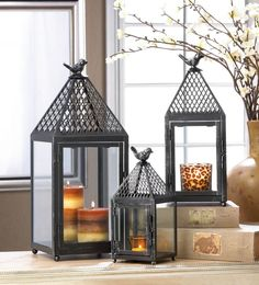 A fantastic latticed top and a perfectly perched bird make these iron lanterns a must-have for your home. Open the hinged door to place the candle of your choice inside and watch the flame dance behin