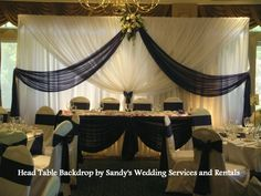 Wedding at UGC May 26, 2012. Chair covers, Head table back drop and Table runners by Sandy at Sandy's Wedding Services & Rentals. See more photos on our Facebook page.