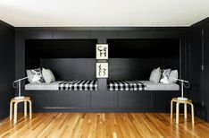 Paper & Pencil - Chic cottage kids' bedroom boasts black paneled built-in beds dressed in black and white sheet sets as well as black gingham blankets.